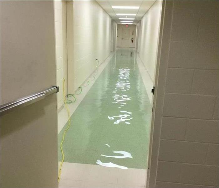 Water in a commercial hallway