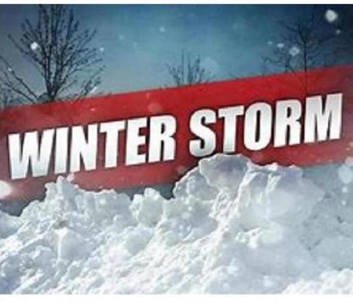 White snow and red winter storm sign