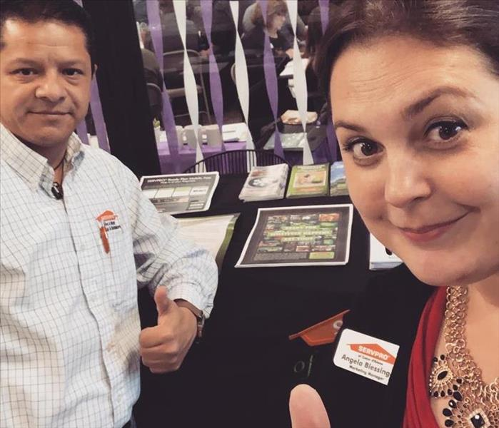 Male and Female SERVPRO employees at an event
