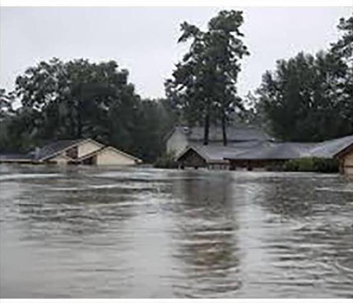 Two houses under water in storm and flood area