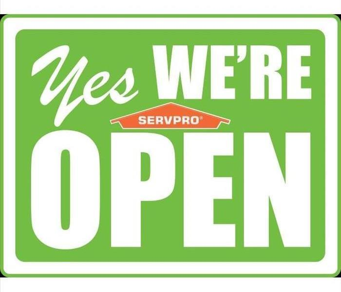 "Green SERVPRO ""Yes We Are Open"" sign"